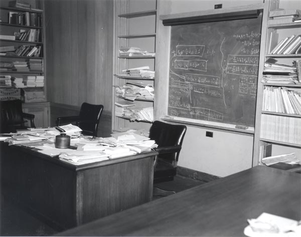 The office of Albert Einstein in Fuld Hall at the Institute for Advanced Study, where he was on the Faculty of the School of Mathematics. Papers are shown in piles on his desk, as well as calculations on the blackboard behind the desk. This photograph was taken in 1955, shortly after Einstein's death and before anything was disturbed. Alan Richards photographer. Courtesy of the Archives of the Institute for Advanced Study, Princeton, New Jersey, USA. (993K)