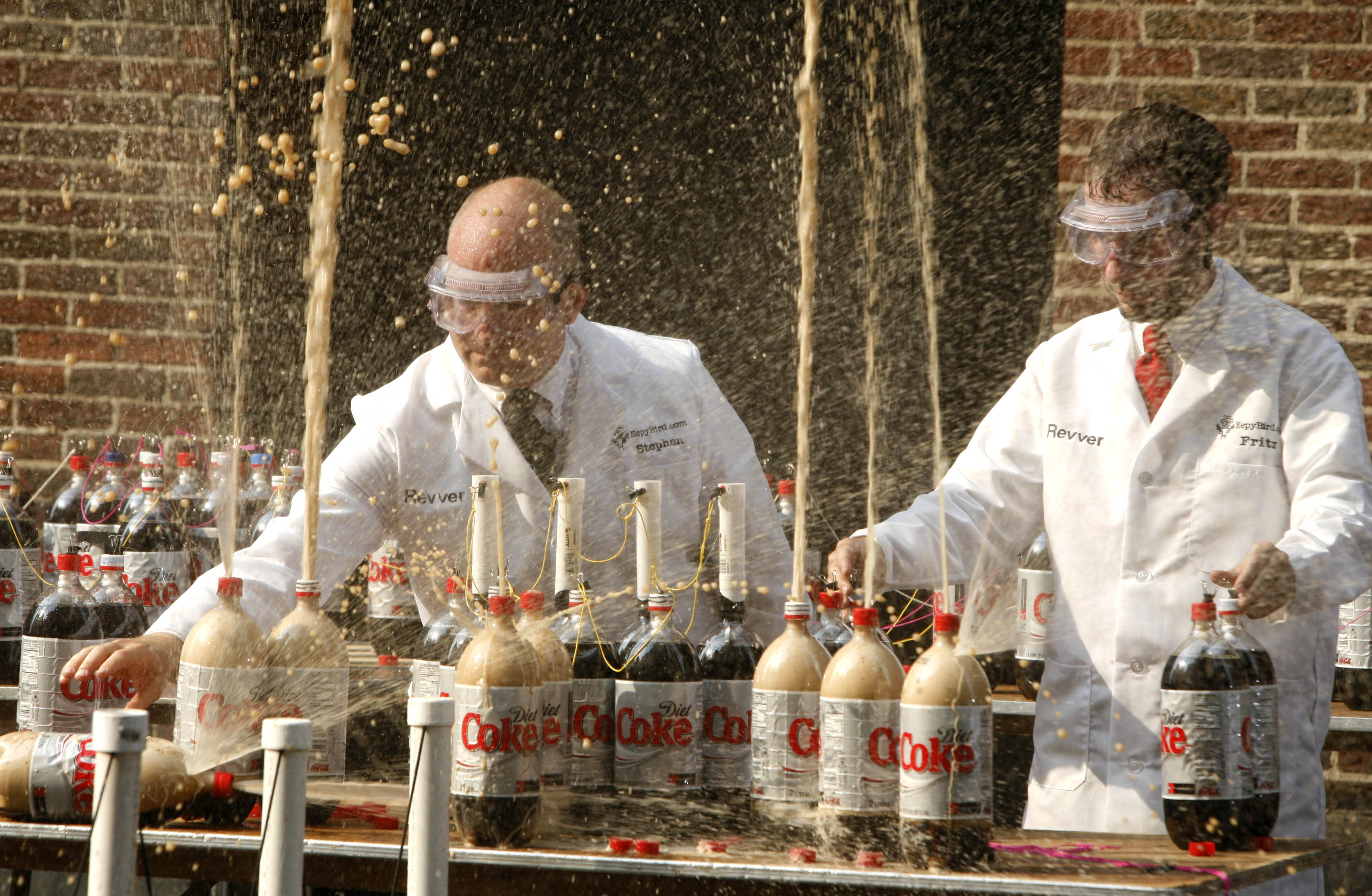 "Stephen Voltz, left, and Fritz Grobe, both of Buckfield, Maine, create a geyser effect from a combination of diet soda and Mentos mints, Thursday, June 29, 2006, during a taping of ""Late Show with David Letterman"", in New York. (AP Photo/Diane Bondareff)"
